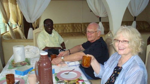 Candy, Doug and Monsignor Francis Tawiah taking 'high tea' between school visits.