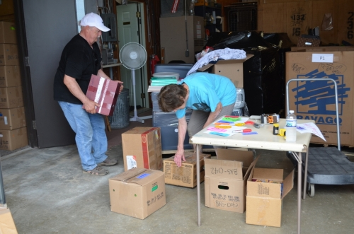 E-Quip Africa volunteers pack donated school supplies for shipment to Ghana, West Africa.