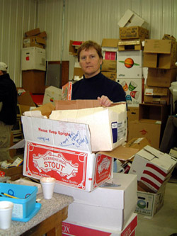 Volunteer loading boxes to be transported from Minnesota (USA) to Ghana